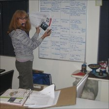 Pam records damaged contents on a whiteboard