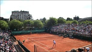 Play on one of the outside courts at Roland Garros