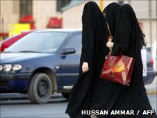 Saudi women walk out of a shopping mall as they wait for their driver to pick them up in Riyadh 