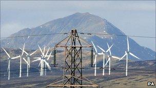 Pylon and wind turbines in Scotland