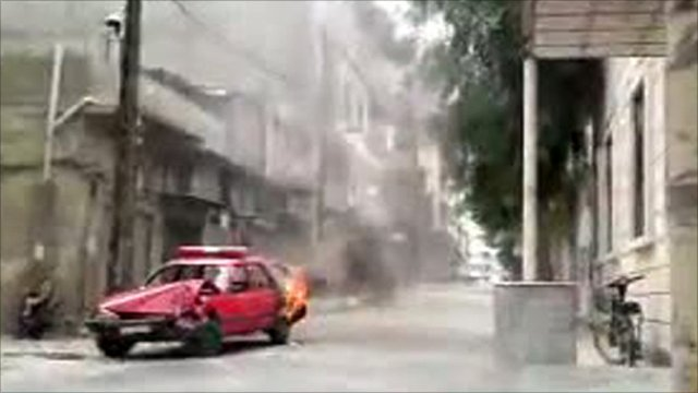 Burning car during protests n Homs, Syria