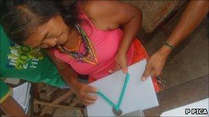 Mundurucu woman with geometry tool (P Pica)