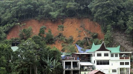 A general view shows a landslide that half buried an orphanage house in Hulu Langat outside Kuala Lumpur May 21, 2011.