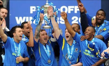 AFC Wimbledon&#039;s Danny Kedwell lifts the trophy