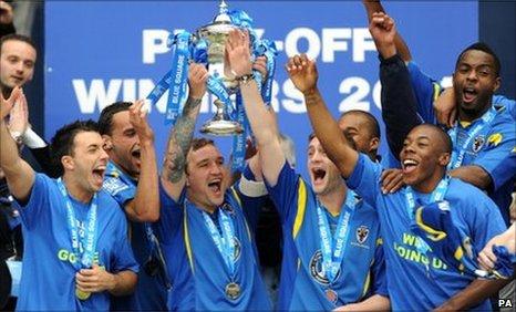 AFC Wimbledon's Danny Kedwell lifts the trophy