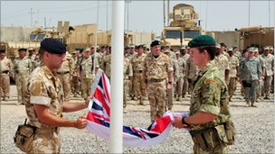 The union jack is lowered at Umm Qasr at the end of the naval training mission