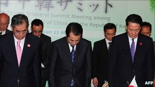 Japanese Prime Minister Naoto Kan, centre, at trilateral talks. 22 May