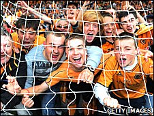 Wolves fans on the pitch 