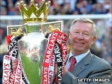 Sir Alex Ferguson with the Premier League trophy