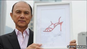 Shoemaker Jimmy Choo with a drawing of one of his creations