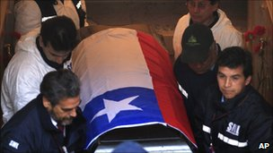 The coffin of Salvador Allende is removed from the family's crypt in in Santiago