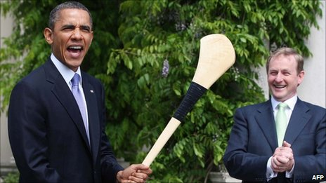 Barack Obama waves a hurley in front of Enda Kenny in Dublin (23 May 2011)