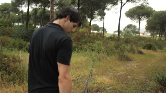 Ramon tracks a pipe from an illegal borehole