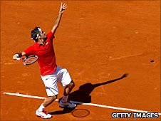 Roger Federer serves in Paris
