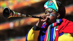 South Africa supporter blows a Vuvuzela
