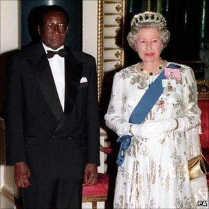 Zimbabwe's President Robert Mugabe and Queen Elizabeth II in London. Photo: 1994