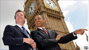 David Cameron speaking with Barack Obama outside the Houses of Parliament in London