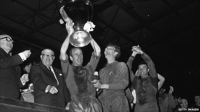 Bobby Charlton holds up the European Cup after Manchester United's victory in the final in May 1968