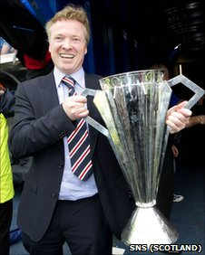 Rangers owner Craig Whyte poses with the SPL trophy