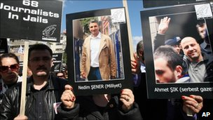 Protesters holding placards of the jailed journalists