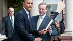 Prime Minister Enda Kenny (right) shows US President Barack Obama the use of a hurling stick