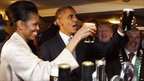 Obama and Michelle drinking a pint of Guinness
