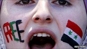 Syrian woman in Jordan protests against President Assad
