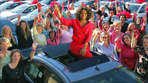 Oprah Winfrey with car winners