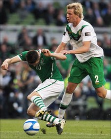 Robbie Keane (left) is fouled by Adam Thompson