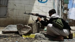 A tribal fighter in Yemen's capital Sanaa near the house of Sheikh Sadeq al-Ahmar - 24 May 2011