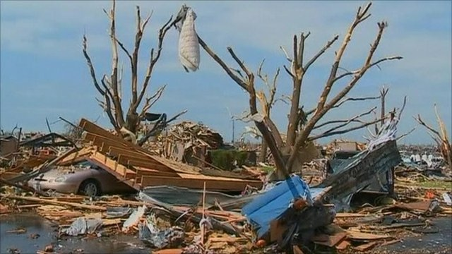 A car crushed by a tree in Joplin