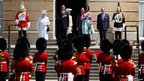 Queen Elizabeth II, US President Barack Obama, Camilla, Duchess of Cornwall, Prince Charles, Prince of Wales, First Lady Michelle Obama and Prince Philip, Duke of Edinburgh listen to the US national anthem during a ceremonial welcome in the garden of Buckingham Palace