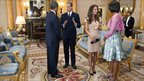 Barack Obama, left, and first lady Michelle Obama, right, meet with Britain's Prince William and the Duchess of Cambridge
