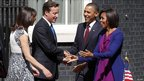 President Barack Obama and first lady Michelle Obama (R) are greeted by Britain's Prime Minister David Cameron and his wife Samantha (L) outside 10 Downing Street