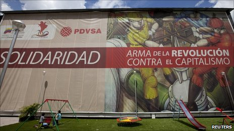Children play at the headquarters of the state oil company PDVSA in Caracas 24 May 2011
