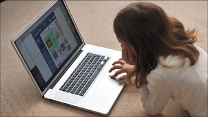 A girl on a laptop computer (generic)