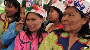 Indigenous women of the Embera ethnic group, among 200 people displaced from their land, at a park in Bogota, Colombia on 30 April, 2011