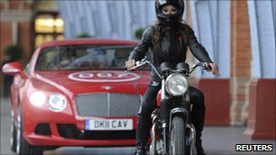 "Model Chesca Miles arrives on a BSA Spitfire motor-bike to launch the new James Bond book ""Carte Blanche"" at St Pancras station"