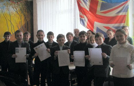 Pupils from Number 4 School hold up their letters to children at their Olympic Dreams partner school