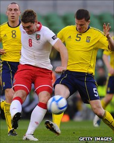 Wales striker Sam Vokes battles with Scotland's Gary Caldwell