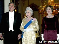 Bush, the Queen and Laura Bush arrive in the White Drawing Room of Buckingham Palace for the State dinner