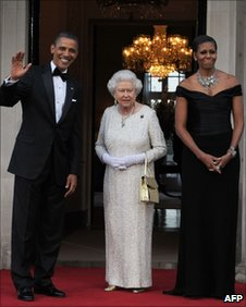US President Barack Obama and First Lady Michelle Obama greet Queen Elizabeth II for a farewell dinner at the official home of the US Ambassador to Britain, on 25 May 2011