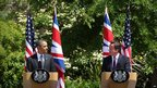 US President Barack Obama answers a question as UK Prime Minister David Cameron looks on during a joint press conference at Lancaster House in London on 25 May 2011
