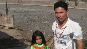 Jonas Ahuanari and his daughter, Zamme, by Lima's river Rimac