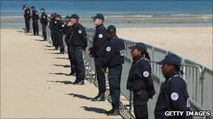 French police patrol the beach at the resort of Deauville on 25 May 2011