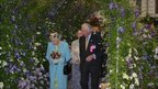 The Queen with Raymond Evison in the tunnel of clematis