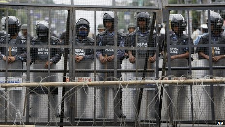 Nepalese police guard the restricted area around the constitutional assembly