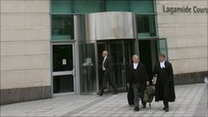 Solicitors exiting court