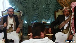 Tribal leader Shiekh Sadiq al-Ahmar (R) and his younger brother Hamid (L) in their house in Sanaa 24 May 2011.