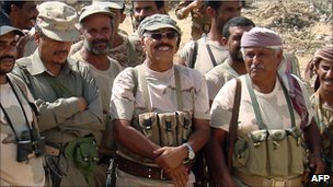 Undated file picture shows Yemeni General Ali Mohsen al-Ahmar (centre) during a visit to troops deployed in Saada province in southern Yemen.